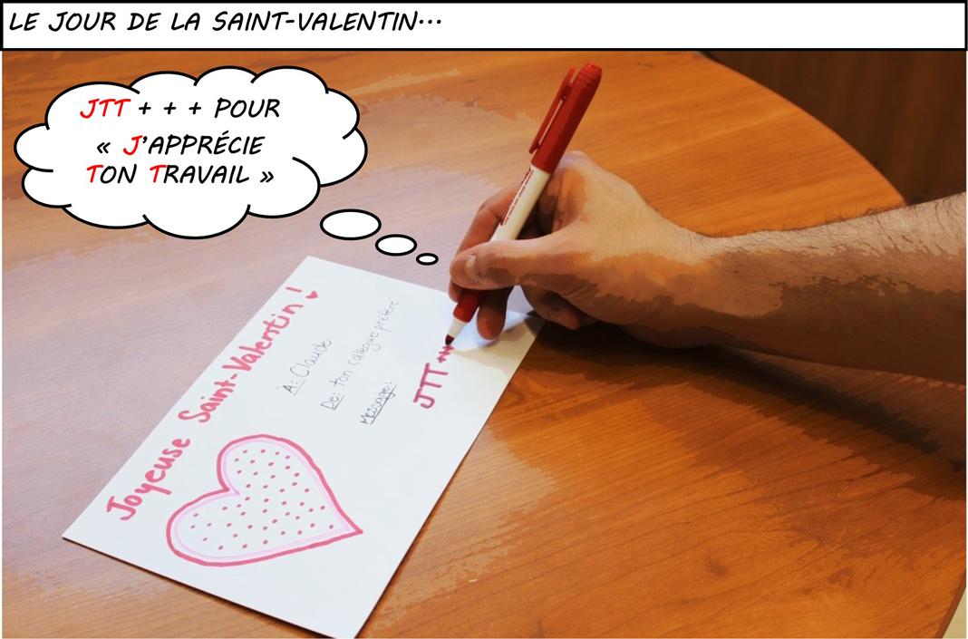 Une main écrit un valentin