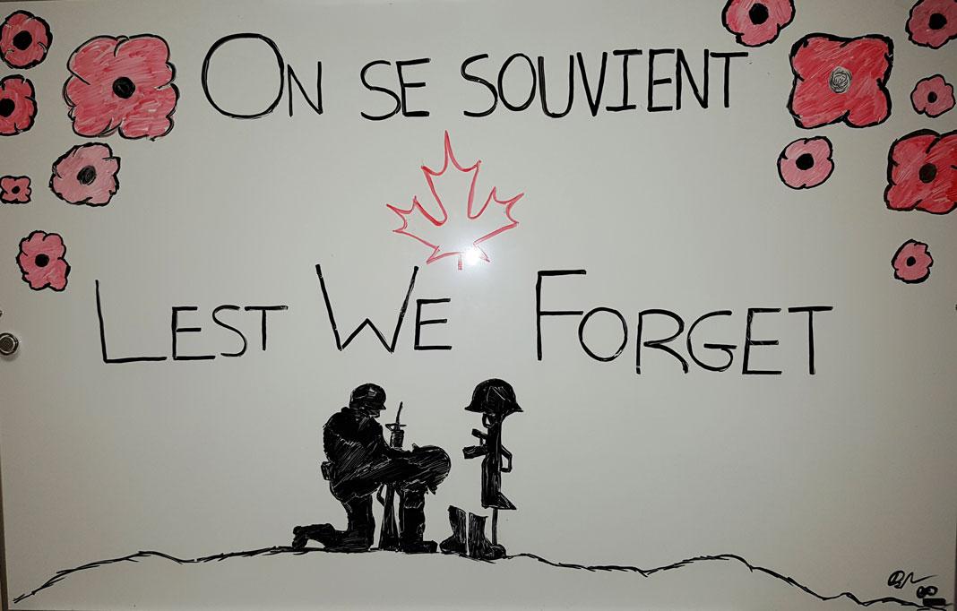 Dessin de coquelicots et soldats sur un tableau blanc